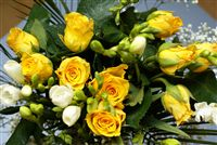 Yellow rose bouquet with freesia flower